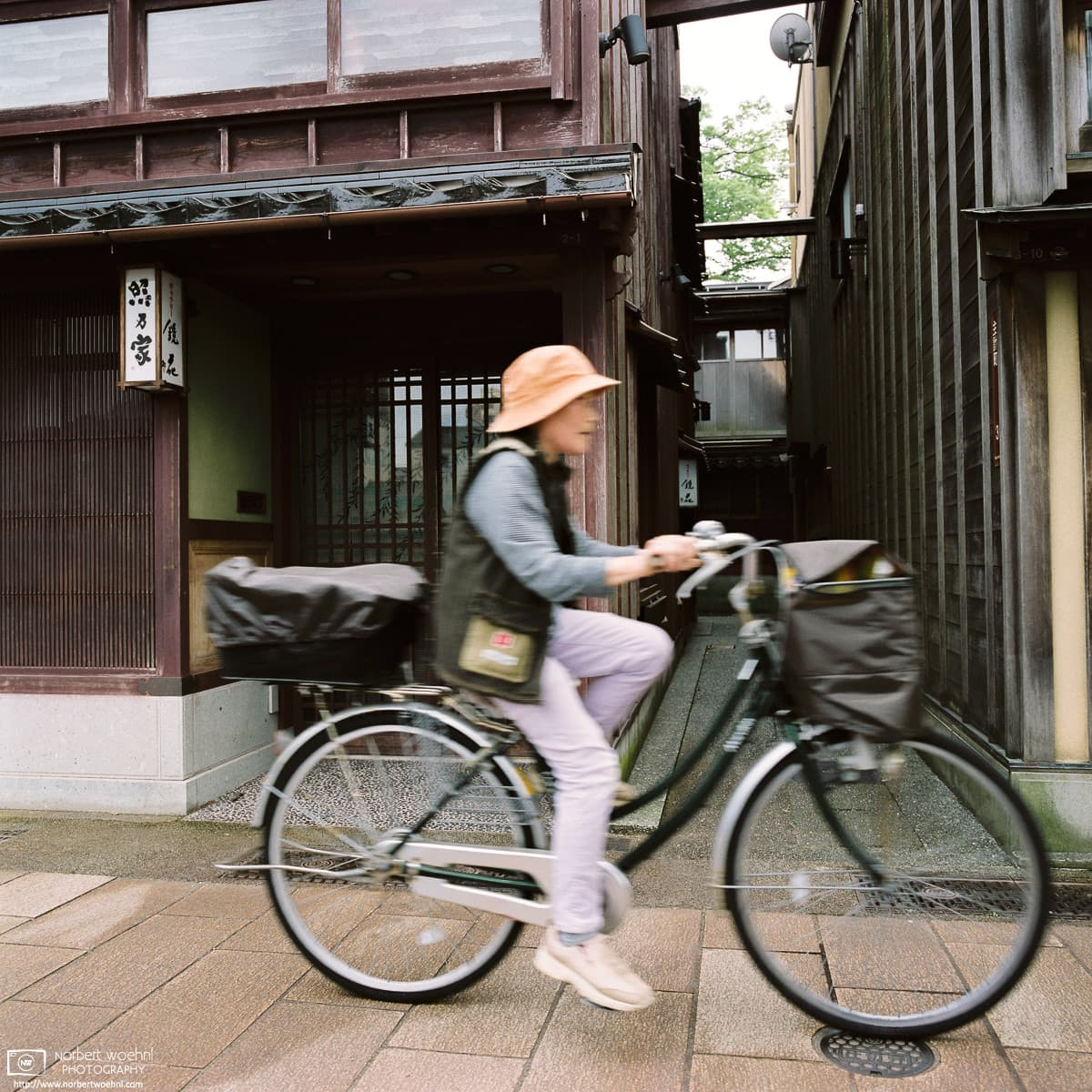 Kazue-machi Chayagai Old Woman Bicycle, Kanazawa, Japan Photo