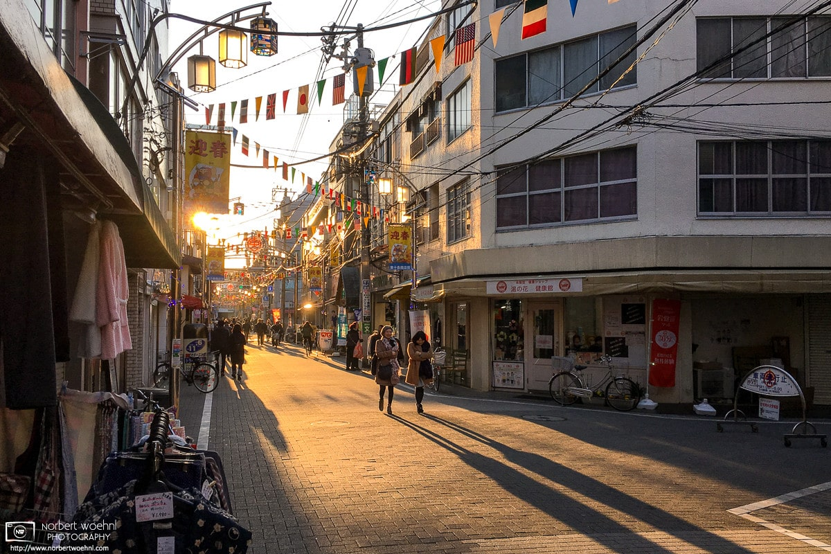 A fine mood created by the setting sun along Higashi-Jujo Shopping Street in Tokyo, Japan.