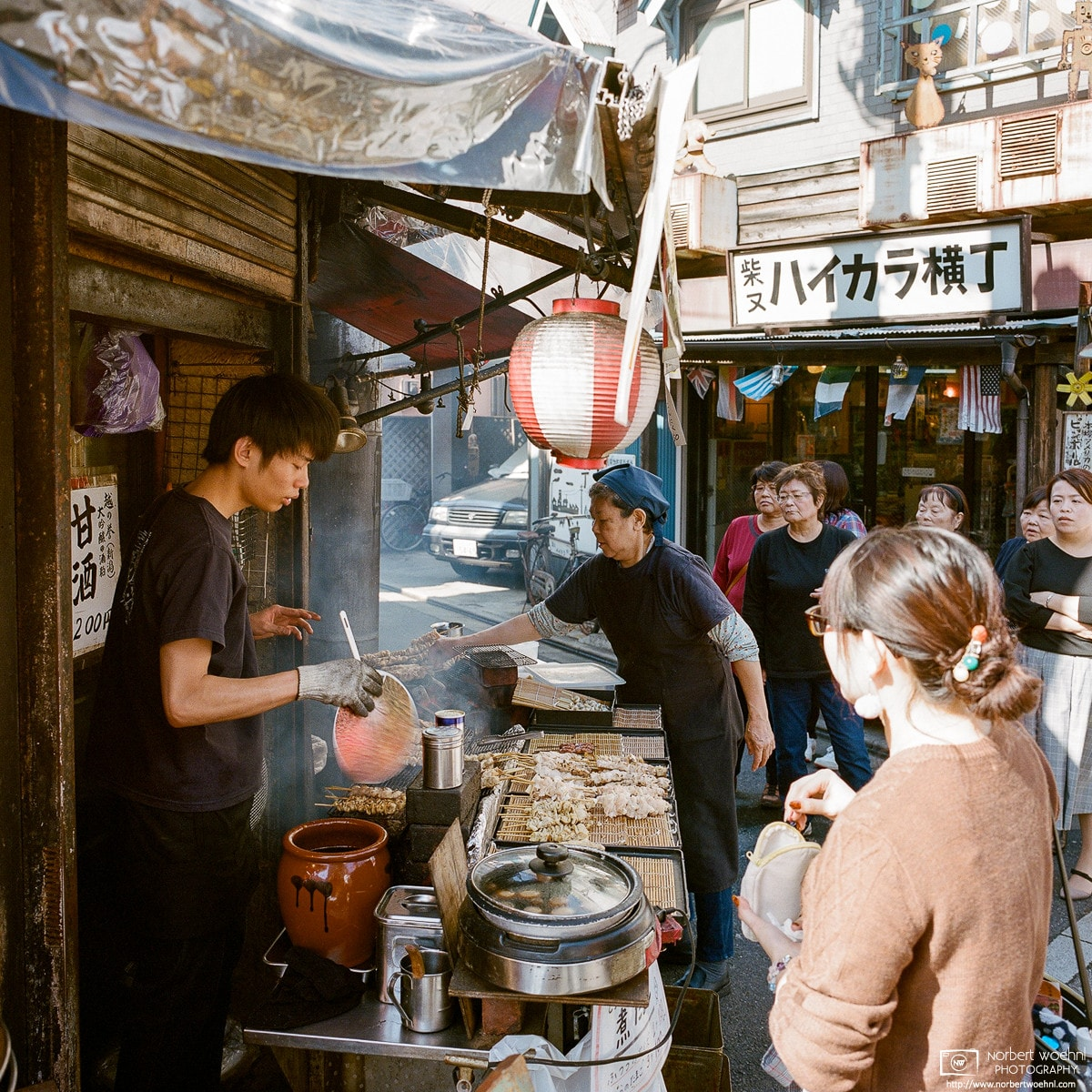 Scene from a Yakitori Stand in the traditional Shibamata (柴又) area in the northeast of Tokyo, Japan.
