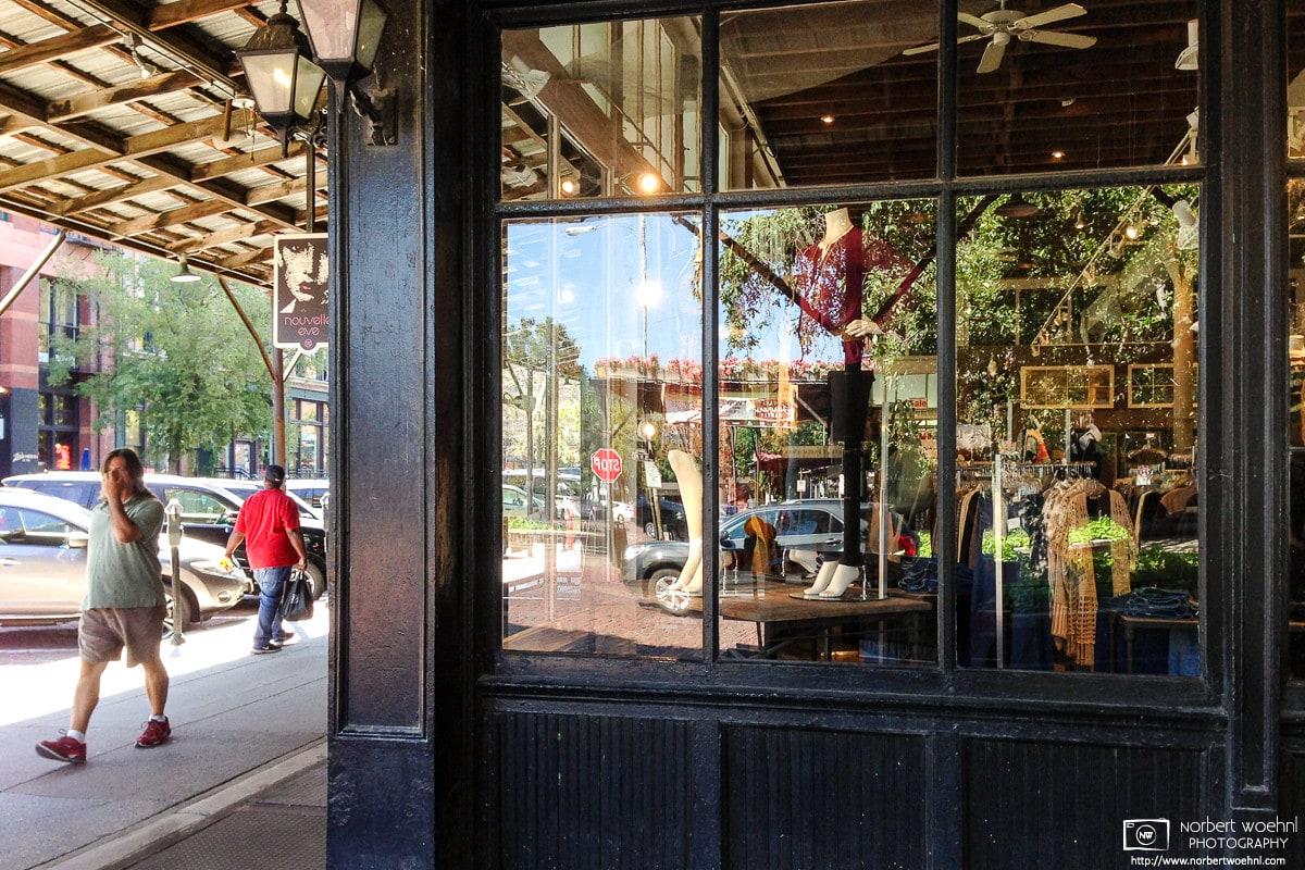 Reflections in a shop window on a street corner in the Old Market neighborhood of downtown Omaha, Nebraska, U.S.
