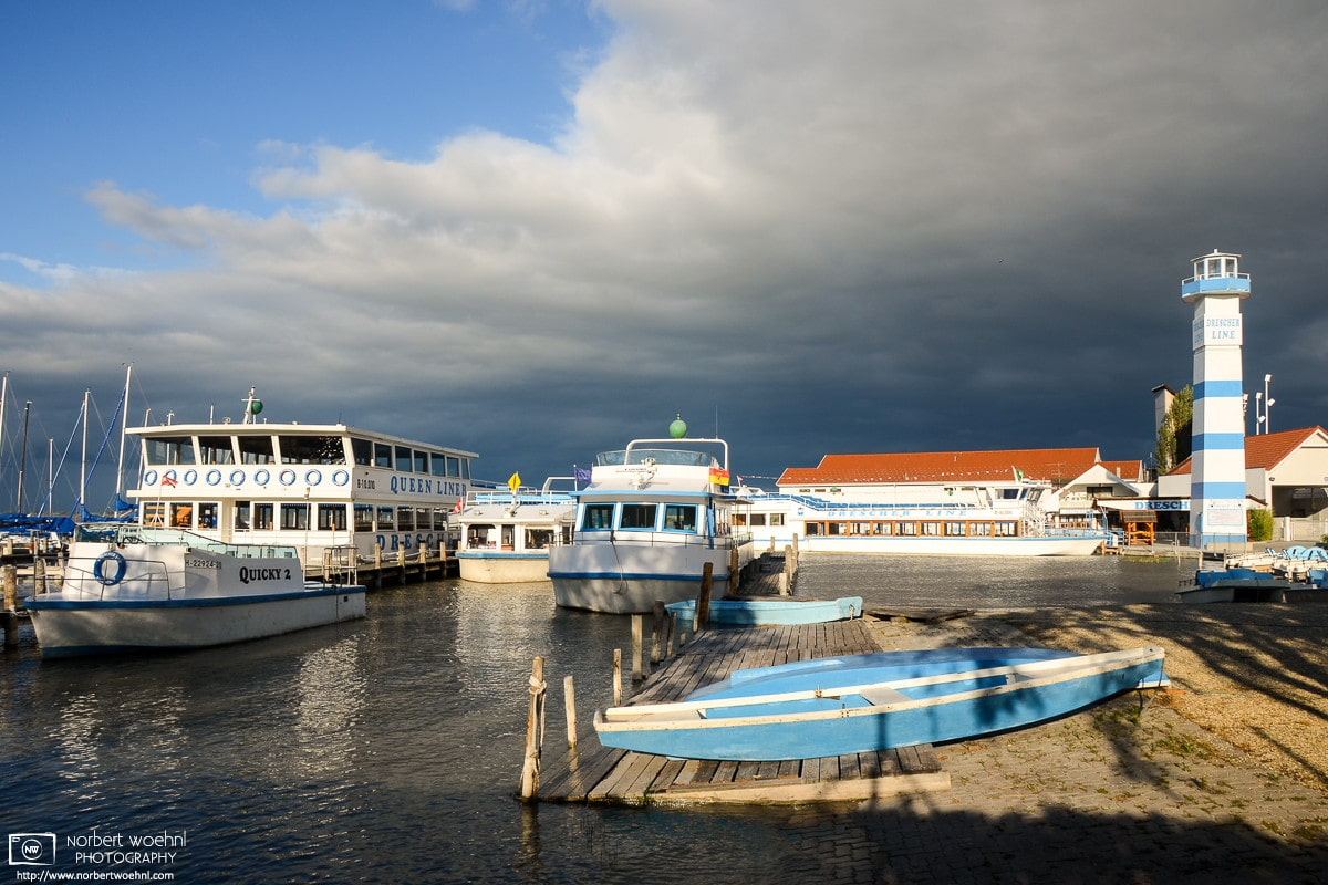 Magnificent light on a stormy afternoon at this boat harbor in Mörbisch on Lake Neusiedl, Burgenland, Austria.