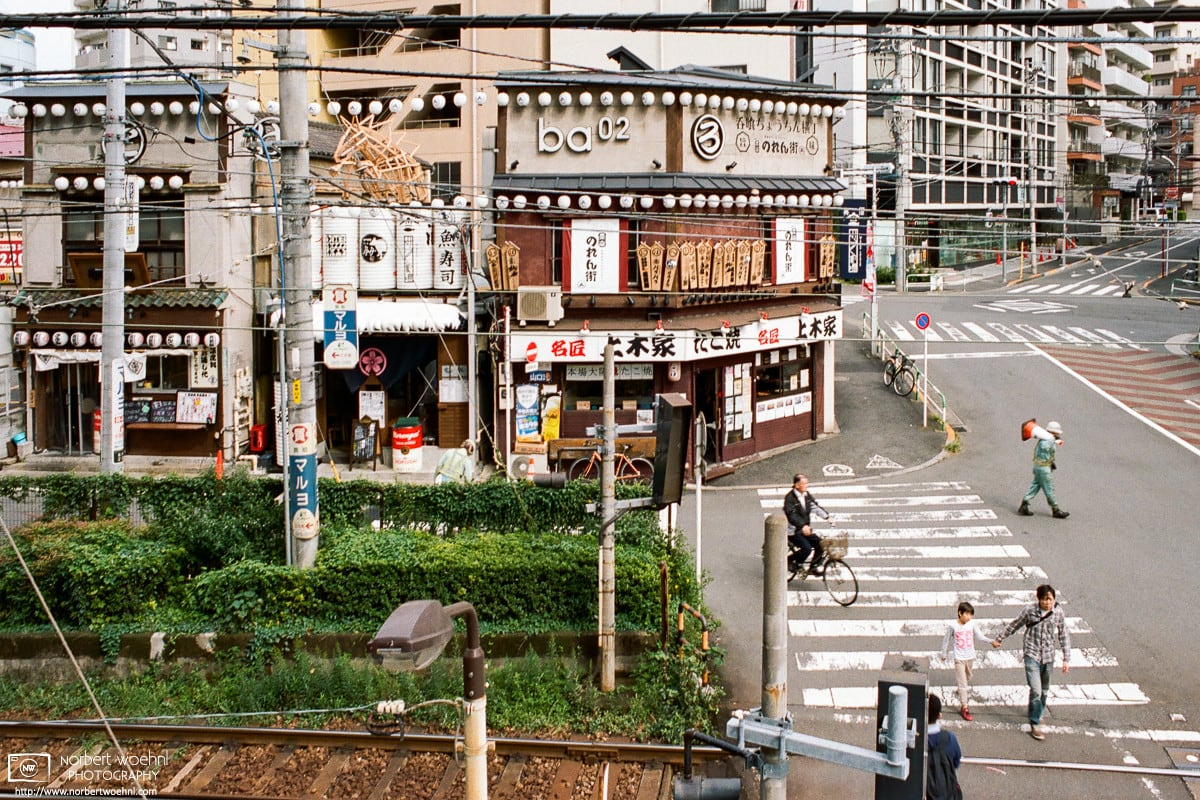 "Old Restaurants around Ōtsuka Station in Tokyo, Japan. The visible train tracks belong to the Toden Arakawa Line, that was re-branded as ""Tokyo Sakura Tram"" in 2017."