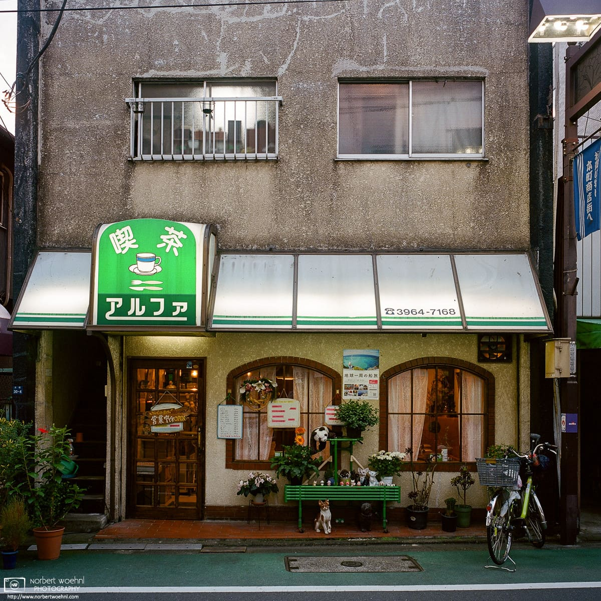 In the Honcho (本町) neighborhood of Tokyo's Itabashi-ku, I took this exterior photo of the Alpha (アルファ) Café at dusk.