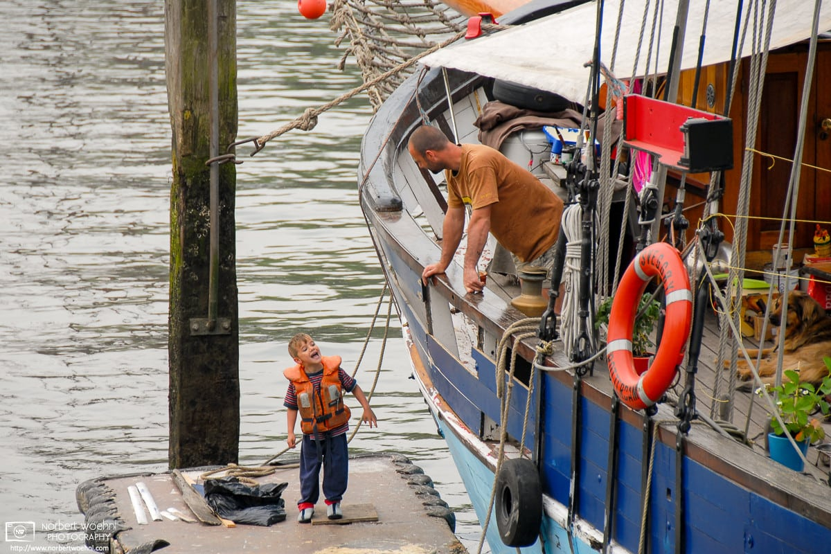 Walking around a small boat harbor in Rotterdam, The Netherlands, I ran into this discussion between father and son.